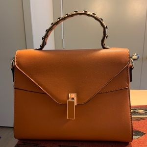 Brown with gold detail hand bag
